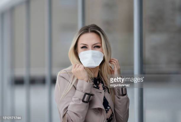 young businesswoman wearing a protective face mask - respirator mask stock pictures, royalty-free photos & images