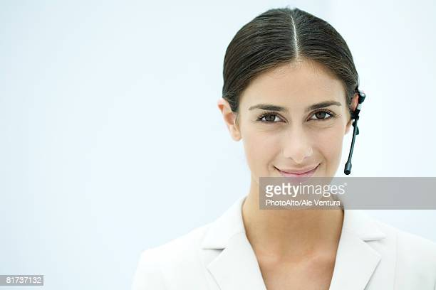 Young businesswoman wearing headset, portrait