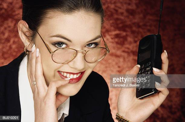 young businesswoman with cellular phone - bavosi stock pictures, royalty-free photos & images