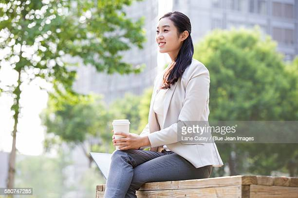 Young businesswoman with coffee cup