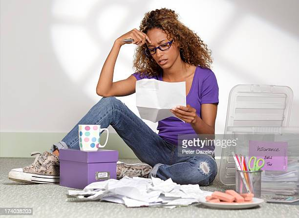 young businesswoman with debts - black trousers stock pictures, royalty-free photos & images