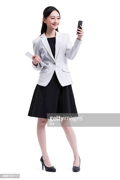 Young businesswoman with digital tablet and smart phone