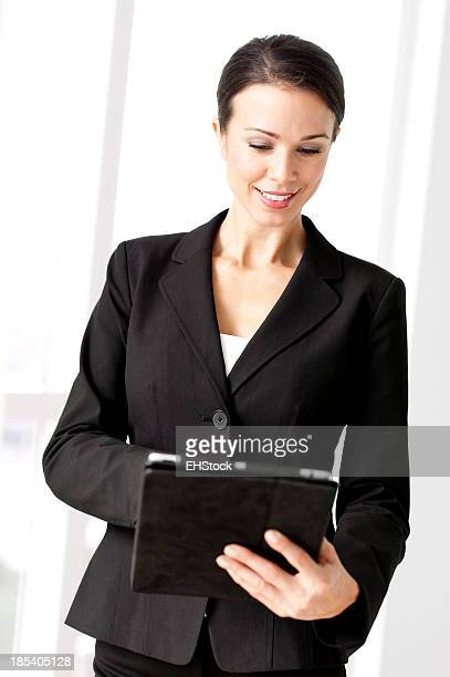 Young Businesswoman with Digital Tablet in Showcase Home
