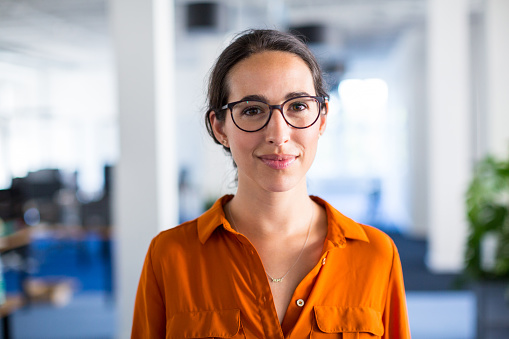 Young businesswoman with eyeglasses in office 825187860
