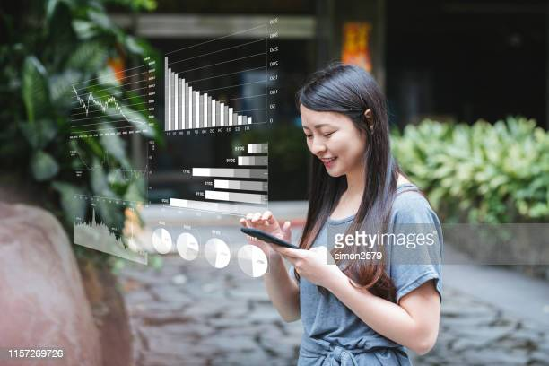 young businesswoman with financial technology concept - financial technology stock photos and pictures