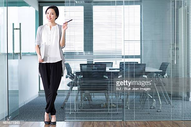 Young businesswoman with laptop in the office