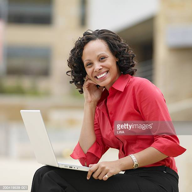 young businesswoman with laptop, smiling, portrait - black blouse stock pictures, royalty-free photos & images