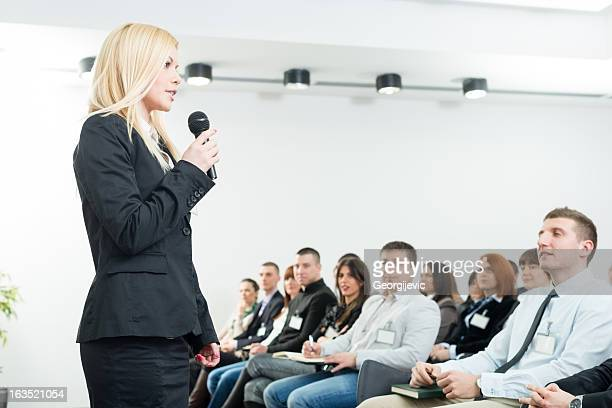 young businesswoman with microphone - big mike stock pictures, royalty-free photos & images