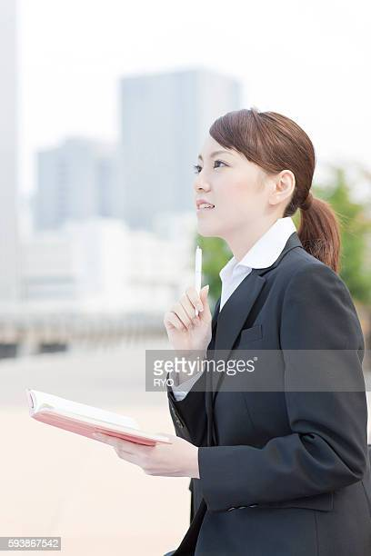 Young Businesswoman with Personal Organizer Outdoors