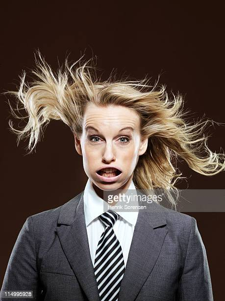 young businesswoman with wind in her face