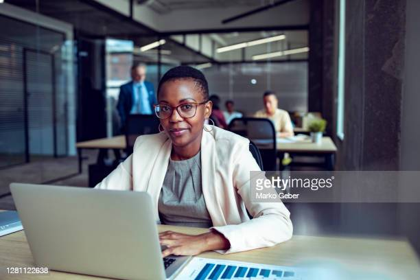 young businesswoman working in an office - diversity stock pictures, royalty-free photos & images