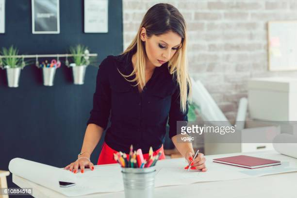 Young Businesswoman Working In Her Office.