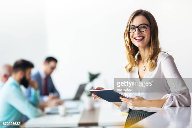 young businesswoman working in modern office on a digital tablet - eyewear stock pictures, royalty-free photos & images
