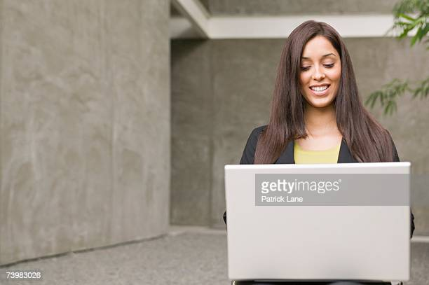 Young businesswoman working on a laptop computer