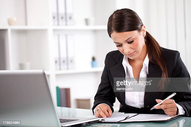 Young businesswoman working on documents