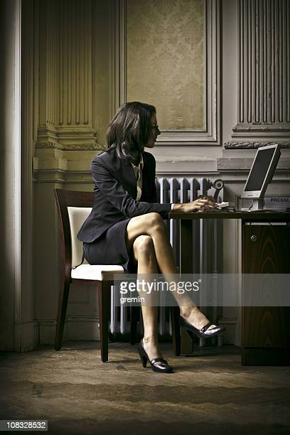 young businesswoman working - high heels short skirts stock photos and pictures