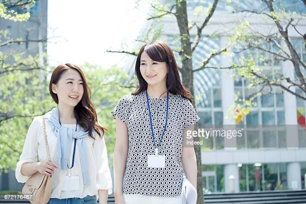 Young businesswomen walking on street