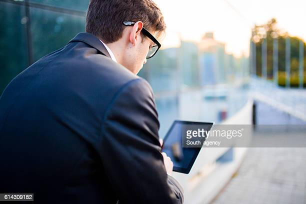 Young busnessman using tablet,rear view