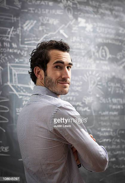 Young bussiness male after using chalkboard