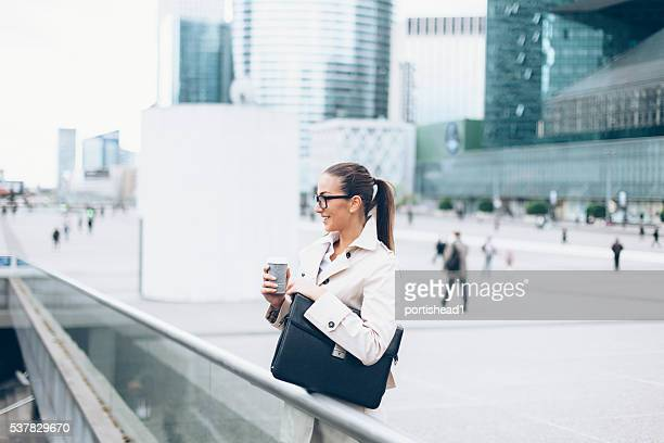 Young bussineswoman drinking coffee outdoor