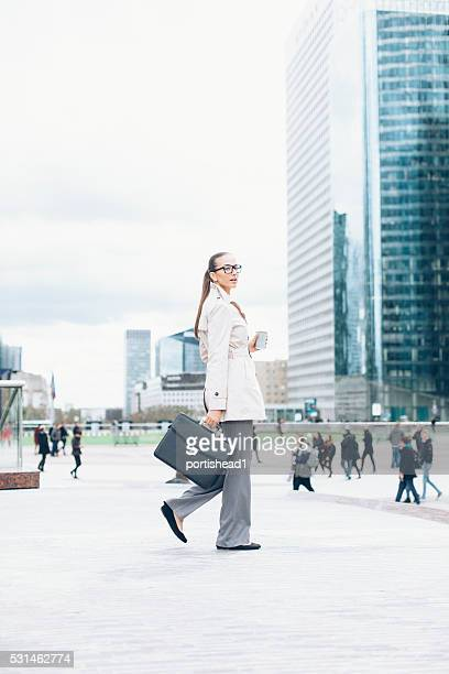 Young bussineswoman walking on street
