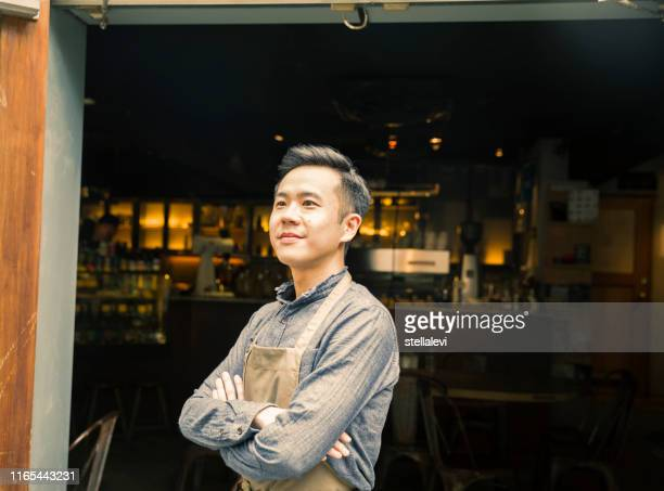 young cafe shop owner portrait or employee working at restaurant - stellalevi stock pictures, royalty-free photos & images