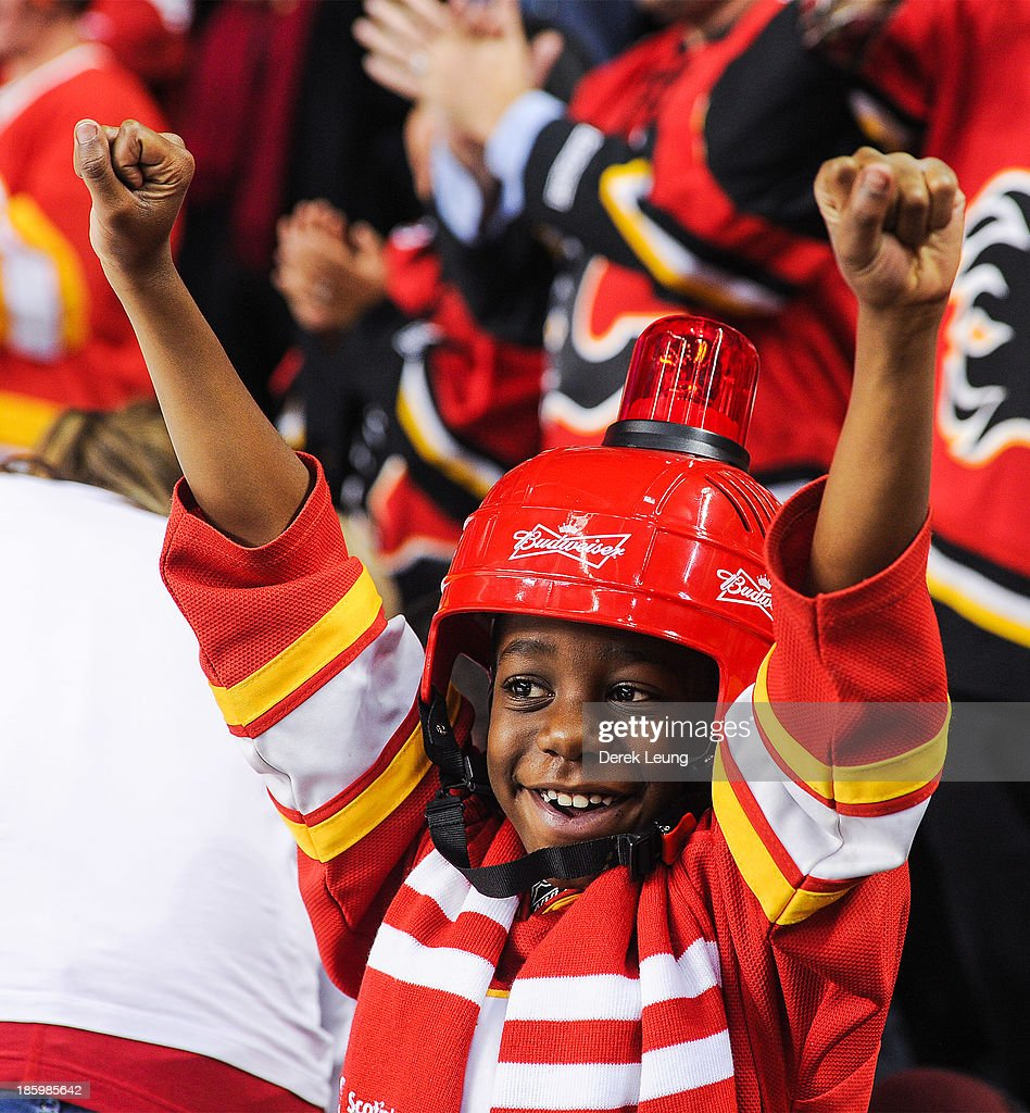 A young Calgary Flames fan celebrates the Flames' victory over the Washington Capitals during an NHL game at Scotiabank Saddledome on October 26, 2013 in Calgary, Alberta, Canada. The Flames defeated the Capitals 5-2.