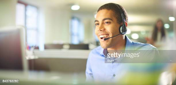 young call centre worker chatting.