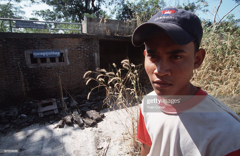 A young Cambodian man stands amidst the ruins of Pol Pot's bunker, close to the Thai border. The leader of the Khmer Rouge, Pol Pot led an extreme Maoist political regime that tried to drag Cambodia back to 'year zero', creating a classless and money-less society. During the Khmer Rouge rule from 1975 to 1978, millions died in forced labour camps and as a result of violent purges..
