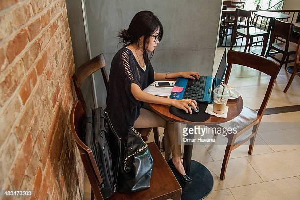 A young Cambodian woman uses her laptop in a local restaurant on April 9 2014 in Phnom Penh Cambodia Leaked to the media for the first time on 9...