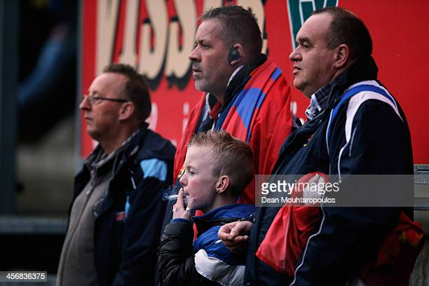 A young Cambuur fan smokes a cigarette as he watches the Eredivisie match between SC Cambuur and Ajax Amsterdam held at Cambuur Stadion on December...