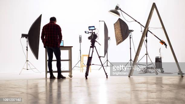 young camera operator in the studio - film set stock pictures, royalty-free photos & images