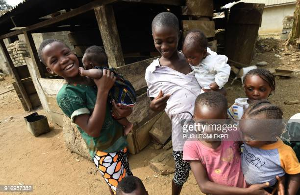 Young Cameroonian refugees carry children in Agborkim town, Etung district of Cross Rivers State, southeast Nigeria, on February 2, 2018. Nigeria on...