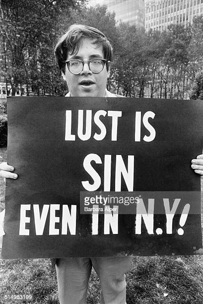 A young campaigner with a sign reading 'Lust is sin even in NY' New York City August 1979