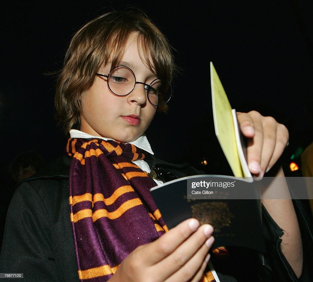 A young Canadian fan dressed up as Harry Potter takes his ticket from within his passport before meeting author J.K. Rowling at a reading and signing of her of her latest novel 'Harry Potter and the Deathly Hallows' at the Natural History Museum on July 20, 2007 in London, England. This the final of seven novels in the Harry Potter collection, which goes on sale from one minute past midnight.