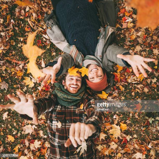 young canadian heterosexual couple enjoying a beautiful autumn day outdoors - autunno foto e immagini stock