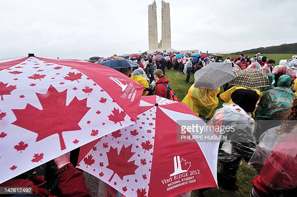 Young Canadian students stand in front of the Canadian memorial as they participate on April 09 2012 in Vimy northern France in the commemoration...