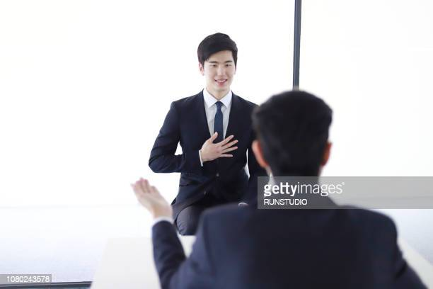 young candidate on job interview - 職探し ストックフォトと画像
