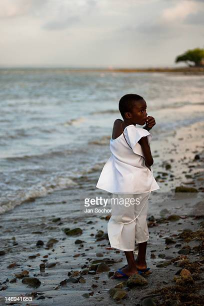 A young Candomblé follower walks along the seashore after the ceremony in honor to Yemanjá the goddess of the sea on 3 February 2012 in Amoreiras...