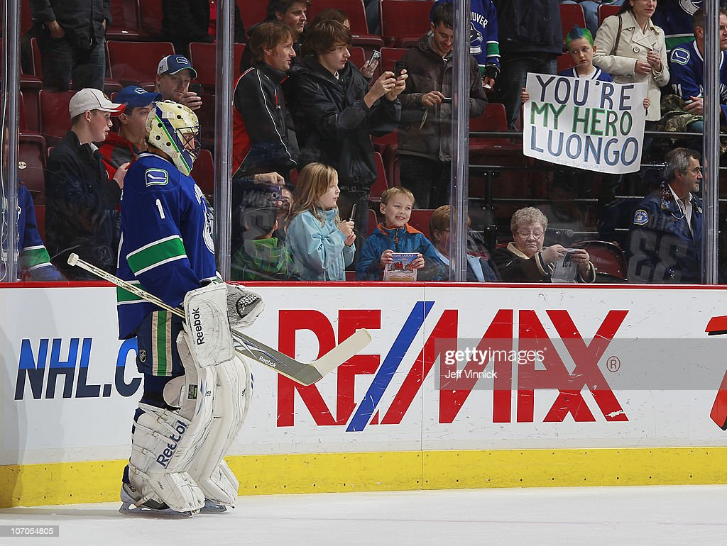 A Young Canucks Fan Looks On At Roberto Luongo Of The Vancouver