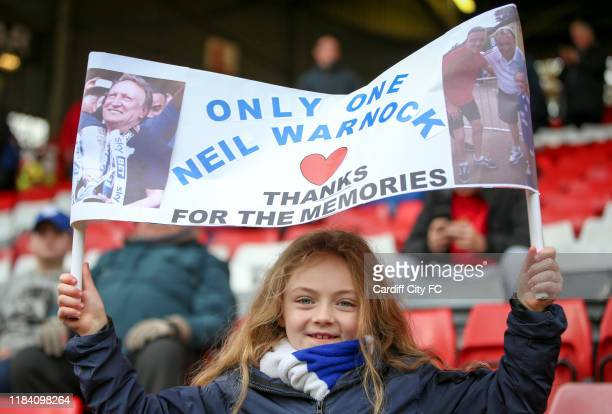 Young Cardiff City fan shows her appreciate for previous Cardiff Manager, Neil Warnock before the Sky Bet Championship match between Charlton...