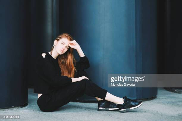 young carefree redhead girl hipster in city street - kneesock stock pictures, royalty-free photos & images