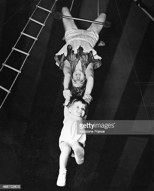 Young Caroline 20 month old trapezist at Chessington circus enjoys when her mother gives her a swing on June 26 1954 in United Kingdom