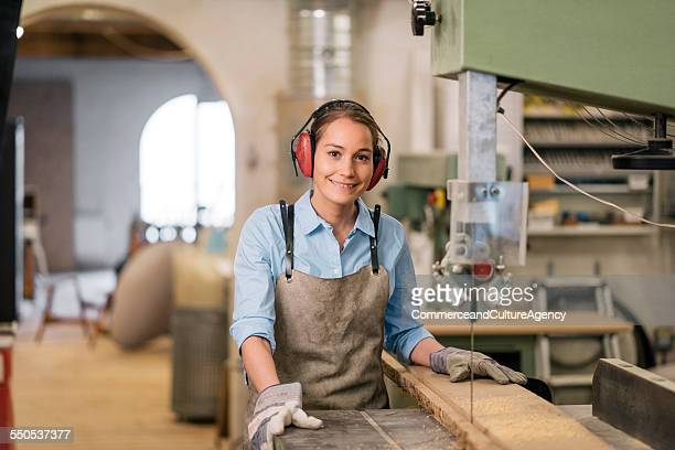 young carpenter in wood workshop