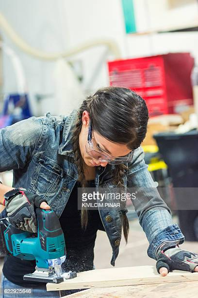 Young carpenter woman