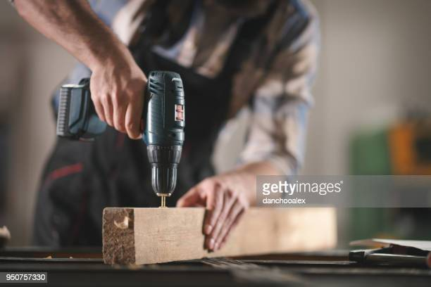 Young carpenter working in his workshop