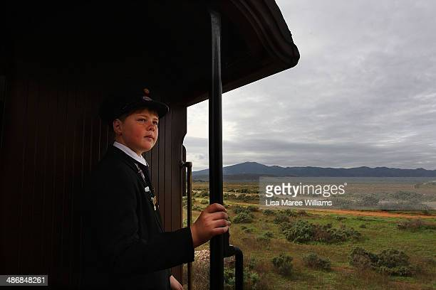 A young carriage attendant stands in the doorway of the Pichi Richi steam train as passengers of The Ghan take a day trip through the Flinders Ranges...