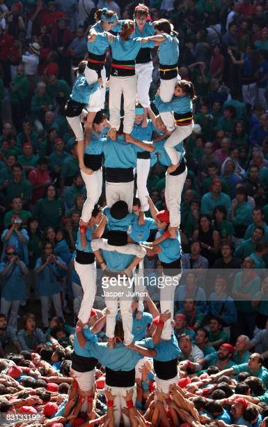 A young castellers of the Castellers de Terrassa 'colle' climb up to build a human tower during the 22nd Tarragona Castells Competition on October 5...
