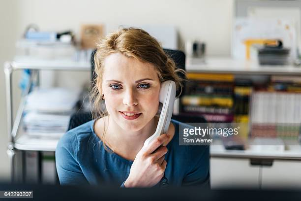 Young casual businesswoman having a call