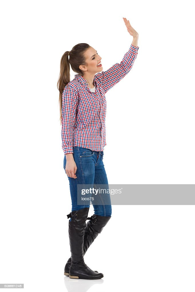 Young Casual Woman Waving : Stock Photo